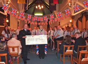 Presenting a cheque to the Army Widows Association at our Night at the Proms concert, 2010